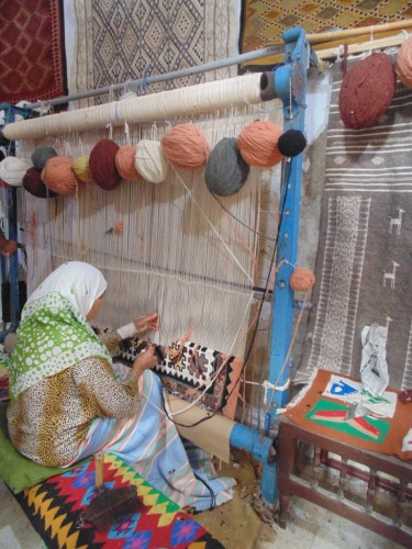 Tunisian woman is making original carpets