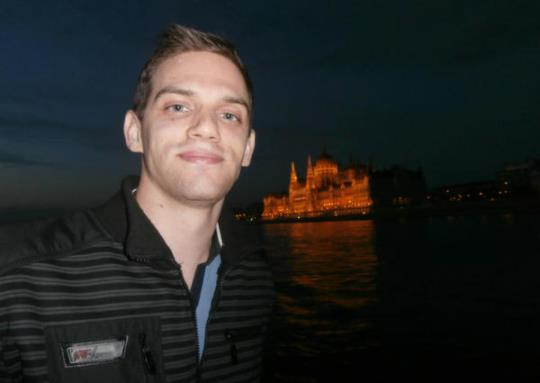 Imre with a backdrop of the Hungarian Parliament building