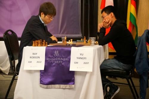 Ray Robson vs. Yu Yangyi (photo credit: Susan Polgar)