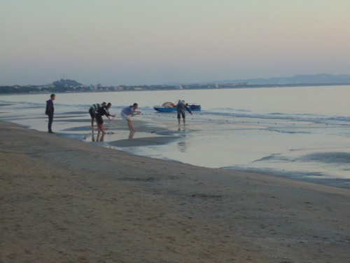 Local kids are taking the fishing net out of the water