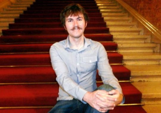 IM Erik Kislik on the velvety stairs of the Hungarian State Opera House