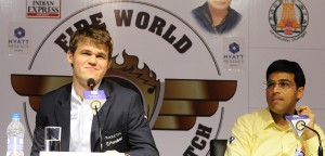 A typical scene from last year's match in Chennai. While Magnus Carlsen confidently answers a question, Vishy Anand seems lost in thought.