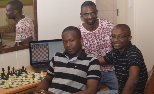 FM Richmond Phiri, IM Stanley Chumfwa and FM Andrew Kayonde, preparing for the round 1 games at Safari Court Resort