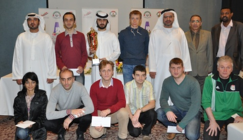 A group photo of all the winners of the rapid tournament and the organisers