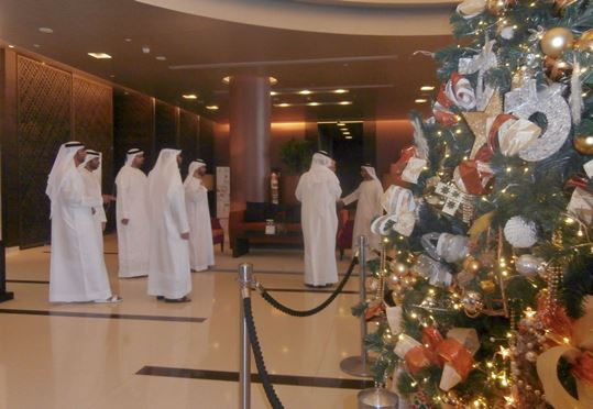 The spacious hotel's lobby displays a giant Christmas tree to meet their international clients
