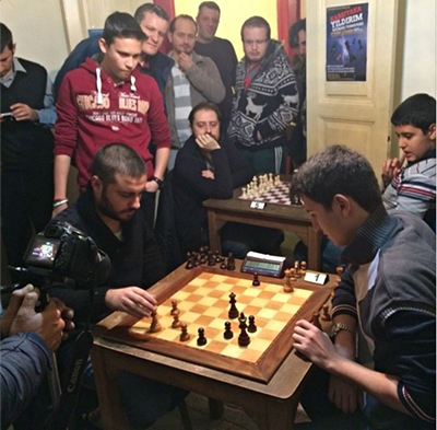 IM Yilmazyerli – FM Soysal. This photo from a previous event really shows the magic attraction of chess.