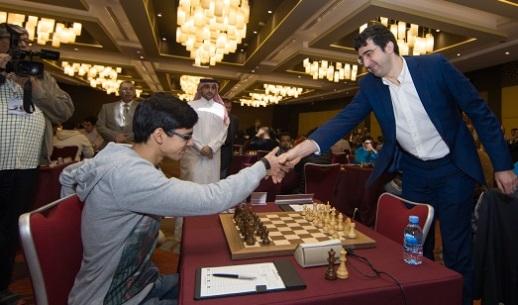 Anish Giri shaking hands with Vladimir Kramnik