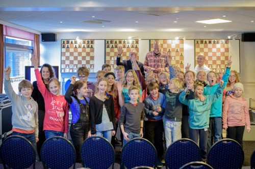The happy children after a simul with IM Robert Ris