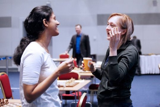 Ushenina explaining to Harika why she was late