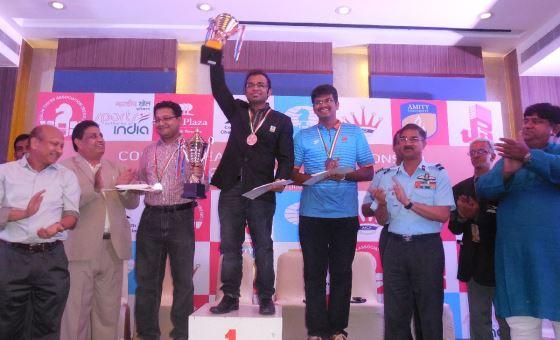 Abhijeet Gupta lifting the trophy