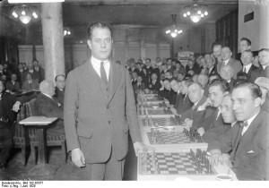 "Photo of Jose Raul Capablanca (""Bundesarchiv Bild 102-07977, Berlin, José Raul Capablanca bei Schachturnier"" by Bundesarchiv, Bild 102-07977 / CC-BY-SA. Licensed under CC BY-SA 3.0 de via Wikimedia Commons)"