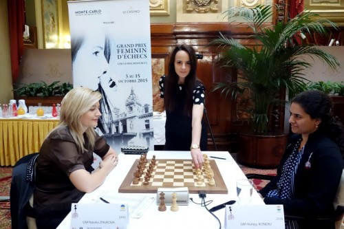 The model of the official placard of Grand Prix in Monaco, Juliette Rapaire,  making the first move in the game Koneru-Zhukova