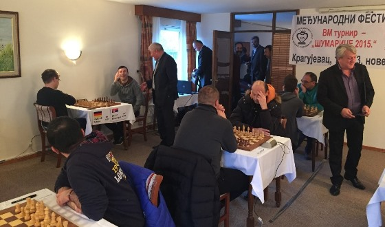 Chess players in good mood before the start of the tournament