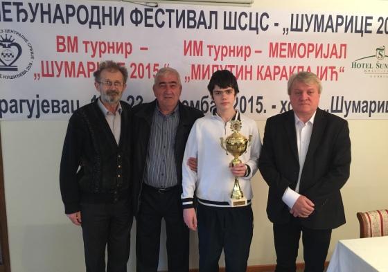 Vuk Djordjevic with the winner's trophy