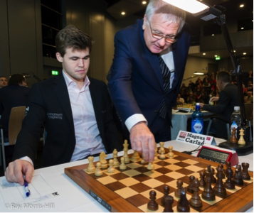 Ken Clark of Newham Council making the ceremonial first move for Magnus Carlsen