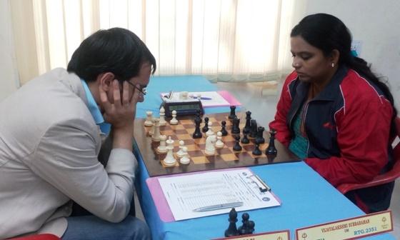 Defending champion Popov Ivan (Russia) playing International Master S Vijayalakshmi