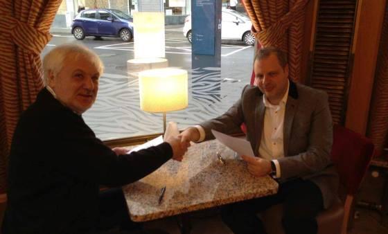 Theodoros Tsorbatzoglou and Pierre Fattebene signing the contract