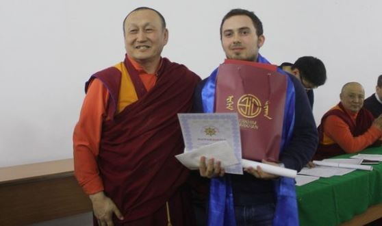 Maxim Chigaev receiving the prize