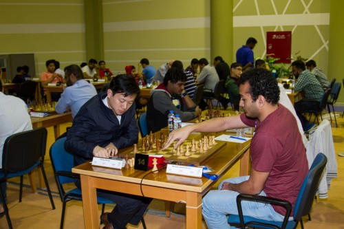 Egyptian GM Hesham Abdelrahman upset the rating favorite GM Zhang Zhong from Singapore