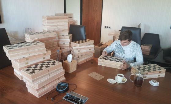 Karjakin signing chess boards